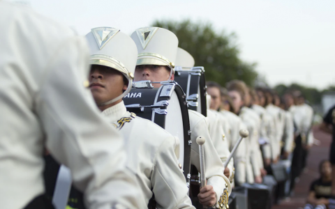 marching band in white uniforms